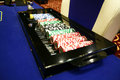 Poker chips roulette blackjack in a box Stock Images