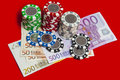 Poker chips stack with euro bills Royalty Free Stock Photo
