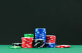 Poker chips stacks of colorful on gambling tables Stock Photos