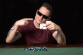 Poker gambler aces a typical player at the table with chips and cards Royalty Free Stock Images