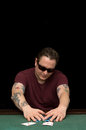 Poker gambler aces a typical player at the table with chips and cards Royalty Free Stock Photography