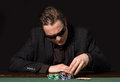 Poker gambler a typical player at the table with chips and cards Royalty Free Stock Photos