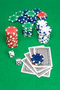 Poker game showing playing cards dice and chips on a green felt gambling table Royalty Free Stock Image