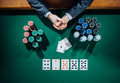 Poker player with cards and chips Royalty Free Stock Photo