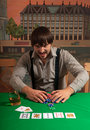 Poker player enjoys winning. Stock Photography