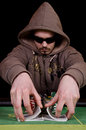 Poker player give the cards a shuffle Royalty Free Stock Photo