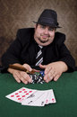 Poker player holding cigar close up playing cards on table Royalty Free Stock Photography