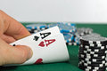 Poker player is showing his pocket cards Royalty Free Stock Photo