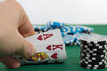 Poker player is showing his pocket cards Stock Photos