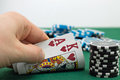Poker player is showing his pocket cards Royalty Free Stock Images