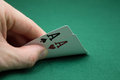 Poker player showing pocket cards Stock Photography