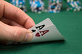 Poker player showing pocket cards Royalty Free Stock Photos
