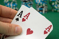 Poker player showing pocket cards Stock Images