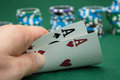 Poker player showing pocket cards Royalty Free Stock Images