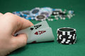 Poker player showing pocket cards Royalty Free Stock Photo