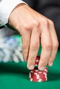 Poker player stakes the pile of poker chips Royalty Free Stock Photography