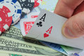 Poker royal flush paper money and gambling chips Stock Photography
