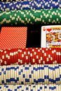 Poker scene a close up of a table with green felt chips and cards Stock Photos