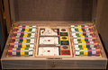 Poker set box playing cards tokens with few deck of and is wooden and can be locked with small golden key Royalty Free Stock Photo