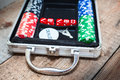 Poker set in metallic case on wooden floor Royalty Free Stock Photo