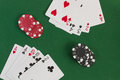 Poker straight and gambling chips on the green background Stock Photo