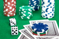 Poker table gambling setting with chips cards and dice Stock Photos