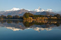 Pokhara lakeside with the reflection of machhapuchhare and the annapurna range in fewa lake Stock Image