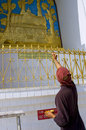 Pokhara nepal may unidentified monk paints the world peac peace pagoda in on Stock Images