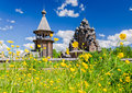 The pokrovskaya church and the bellfry seen through the thickets of ranunculus acris saint petersburg suburbs russia bogoslovka Royalty Free Stock Photos