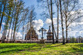 The pokrovskaya church the bellfry and the wayside cross behind the birch trees saint petersburg suburbs russia bogoslovka manor Stock Images