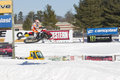 Polaris red black snowmobile high in the air eagle river wi march and during a race on march eagle river wisconsin Stock Photography