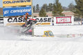 Polaris red black snowmobile soaring on jump eagle river wi march and during a race march in eagle river wisconsin Stock Photography