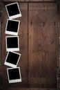 Polaroid photo frame on wood Royalty Free Stock Photo