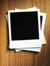 Polaroid style photo frame on wood background Royalty Free Stock Images