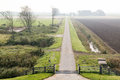 Polder with road in friesland netherlands small hazy frisian landscape countryside near harlingen Stock Photo