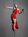 Pole dance girl with wine Royalty Free Stock Photo
