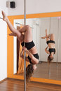 Pole dancer training Stock Photos