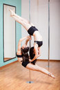 Pole dancing beautifully together Royalty Free Stock Photo