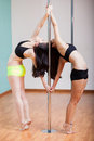 Pole dancing together Royalty Free Stock Photo
