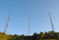 A pole signals the radio at have background is bright sky Stock Photos