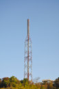 A pole signals the radio at have background is bright sky Stock Images