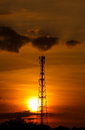Pole telecoms with silhouette sunset Royalty Free Stock Photo