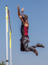 Pole vaulting over the bar a vaulter makes a attempt at a track meet in cottonwood california Royalty Free Stock Images