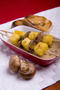 Polenta with mushrooms brochettes Royalty Free Stock Photography