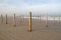 Poles on beach Royalty Free Stock Photo