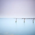 Poles and soft water on water landscape. Long exposure. Stock Photos