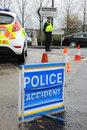 Police accident scene on a busy highway close road following an dull wet and stormy day Stock Image