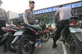 Police arrest motorcycle that broke the rules of traffic in the city of solo central java indonesia Royalty Free Stock Photos