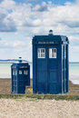 Police boxes two retro telephone on a beach Stock Photography