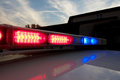Police car light bar strobelight on top of flashing red and blue Stock Images